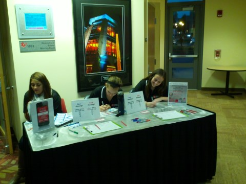 Casey, Olivia, and Stephanie work the sign-in table