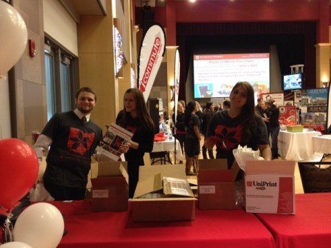 Staff members Nick, Emily and Casey greet housing fair attendees