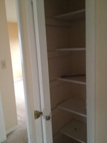 linen closet with view of bedroom 2